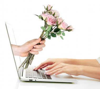 Male hand giving flowers to woman from laptop screen isolated on white stock vector