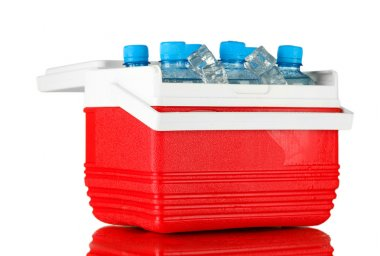 Traveling refrigerator with bottles of water and ice cubes, on whitte background