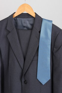 Suit and tie on hanger on white background