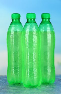 Assortment of bottles with tasty drinks, on bright background