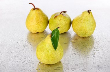 Pears on metal background