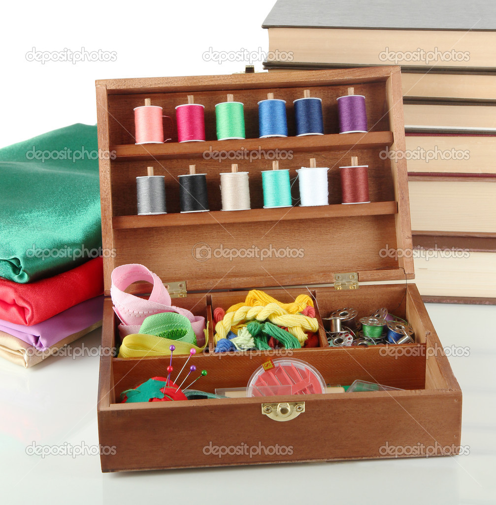 Book Cover Sewing Kits ~ Sewing kit in wooden box with books and cloth isolated on