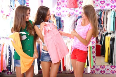 Three beautiful young woman in shop