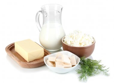 Fresh dairy products with greens isolated on white