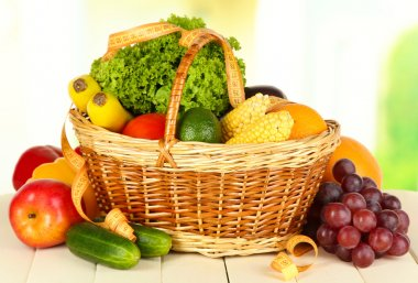 Fresh vegetables on table on light background