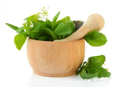 Fresh herbs in mortar, isolated on white