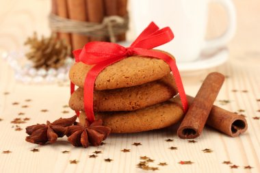 Cookies for Santa: Conceptual image of ginger cookies, milk and christmas decoration on light background