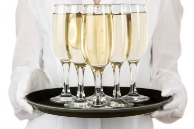 Waitresses holding tray with glasses of champagne, isolated on white