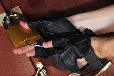 Robber breaks castle in door close-up