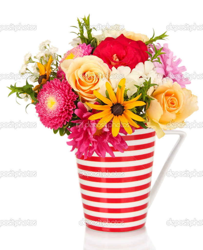 Beautiful bouquet of bright flowers in color mug, isolated on white ...