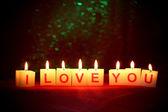 svíčky s tištěnou znamení, miluji tě, na rozostření pozadí světla