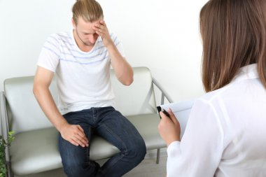 Man with problem on reception for psychologist