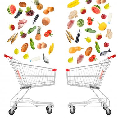Food products falling in shopping cart isolated on white
