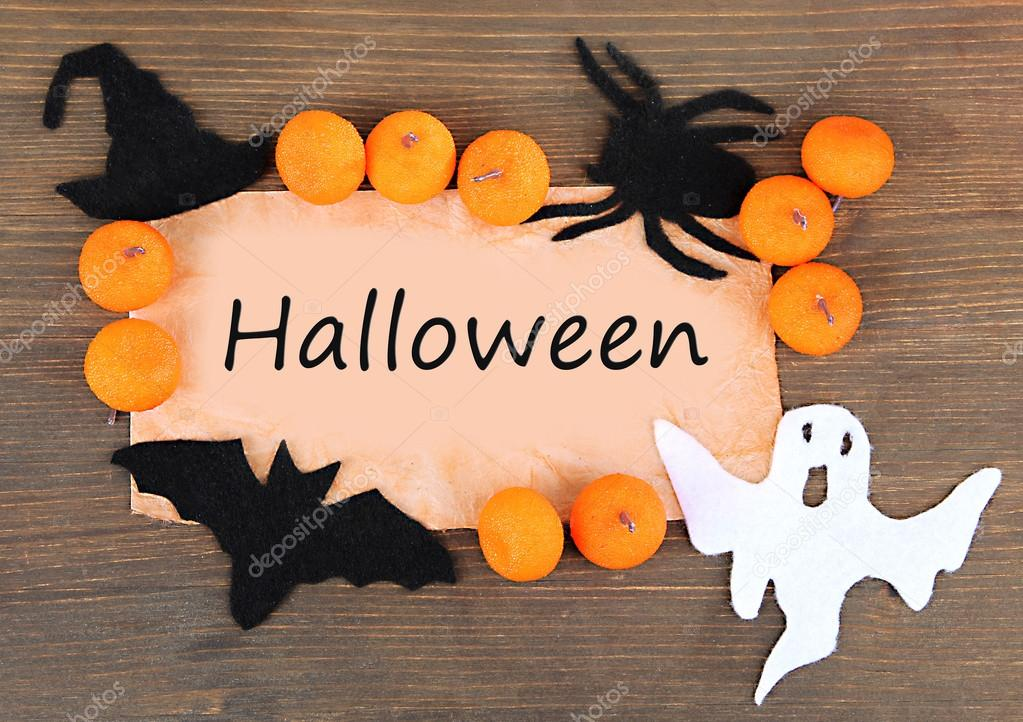 old paper with halloween decorations on grey wooden background stock photo 33526375 - Halloween Decorations Paper
