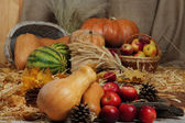 Fruits and vegetables with baskets on straw close up