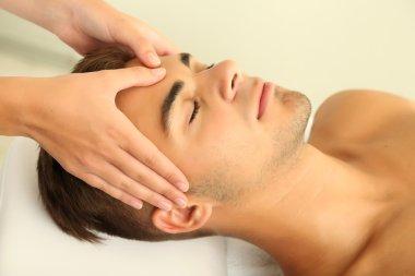 Man having head massage close up