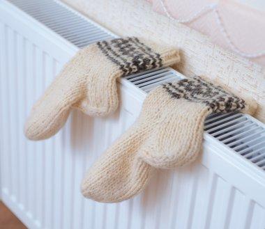 Socks drying on heating radiator