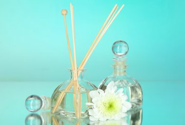 Aromatic sticks for home with floral odor on blue background