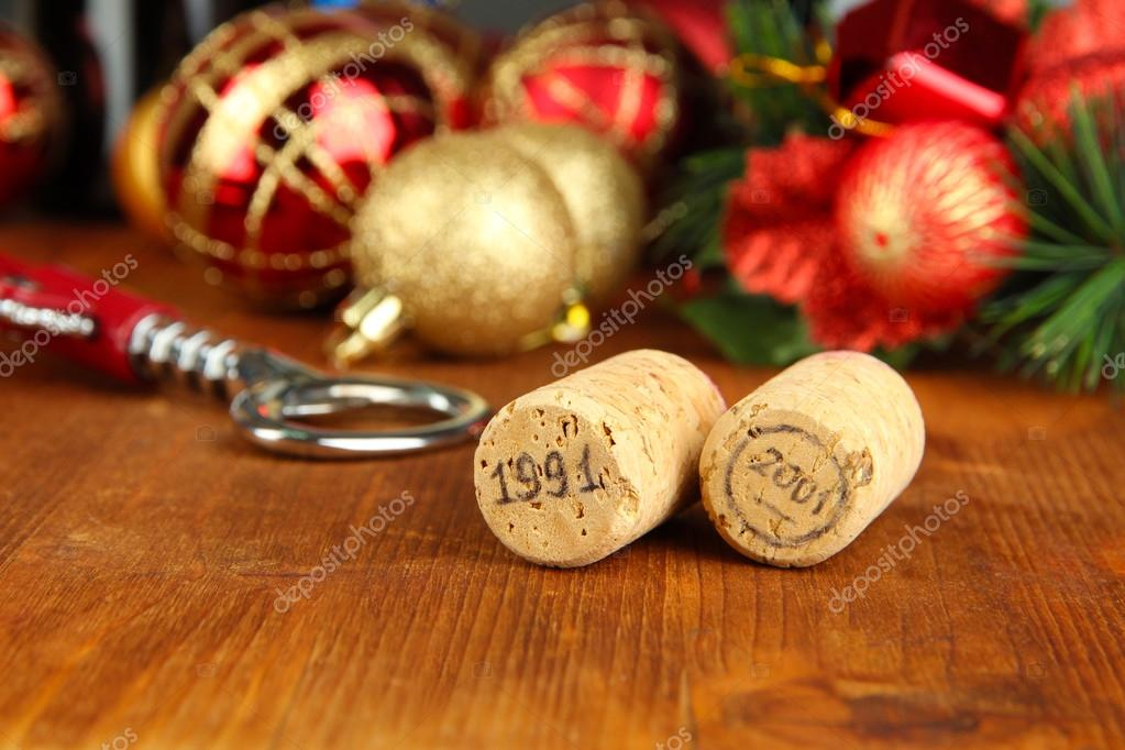 Wine corks with new Year toys on wooden table close-up