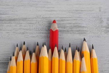 """Картина, постер, плакат, фотообои """"праздничный карандаш среди обычных карандашей, на цветном фоне """", артикул 35696755"""