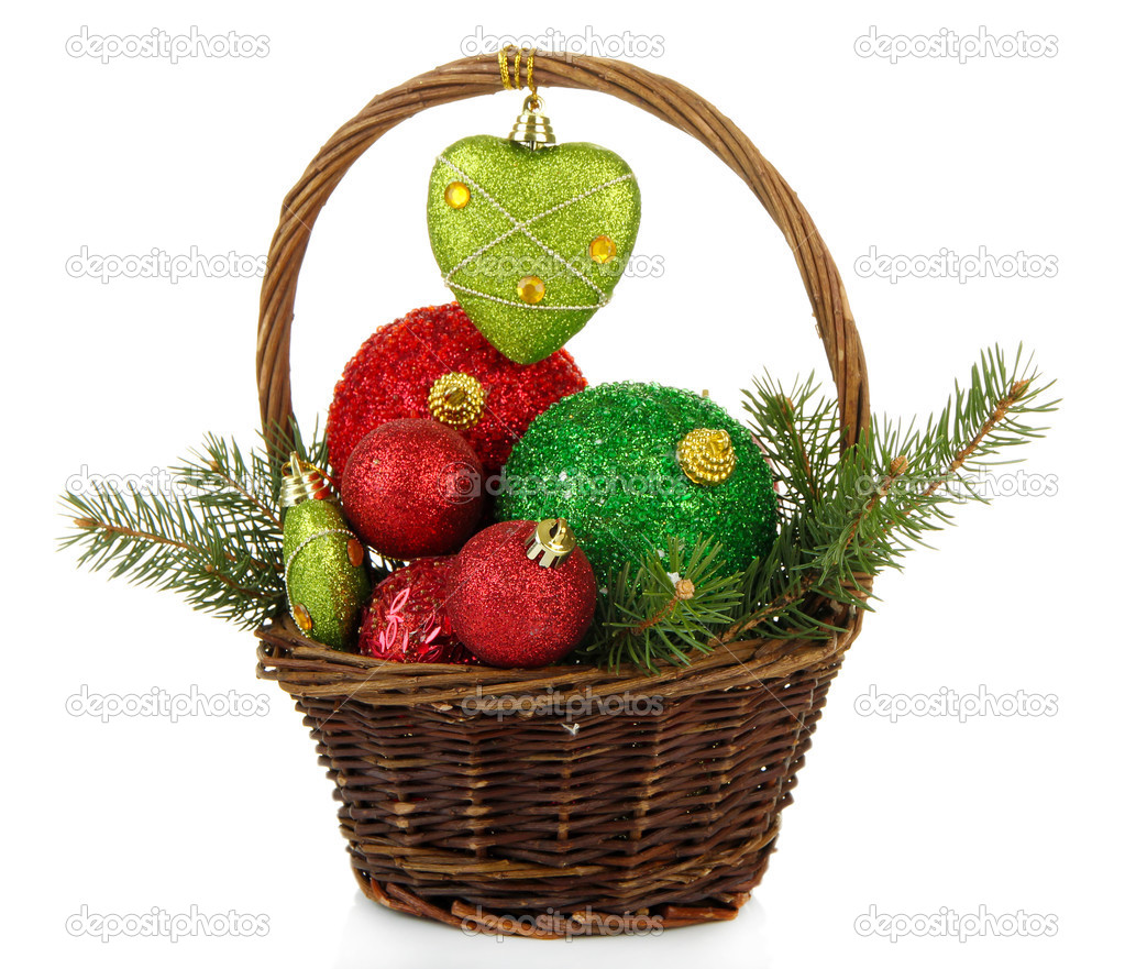 christmas decorations in basket isolated on white photo by belchonock
