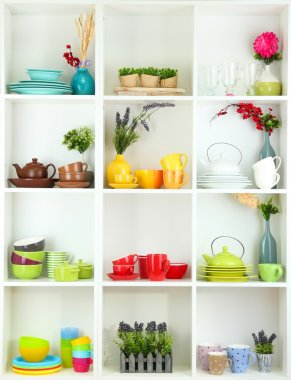 Beautiful white shelves with tableware and deco