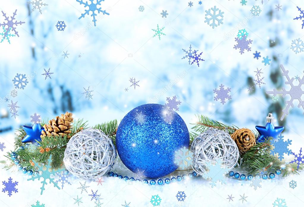Composition of the Christmas decorations on light winter background
