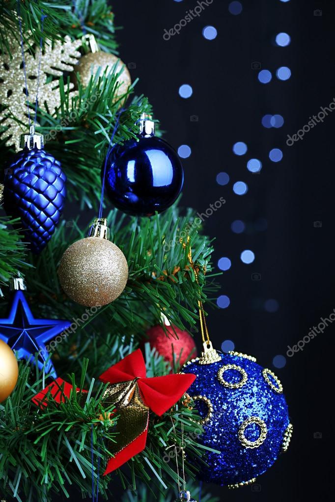 Toys on Christmas tree on Christmas lights background
