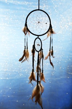 Beautiful dream catcher on blue background with lights