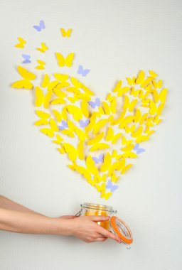 Paper yellow butterfly in form of heart fly out bank