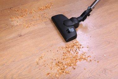 Vacuuming floor in house