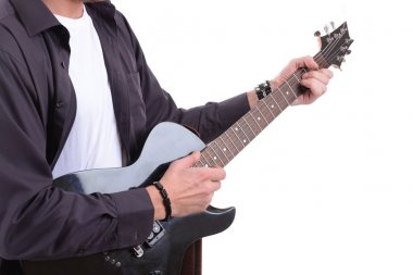 Young musician playing guitar, isolated on white