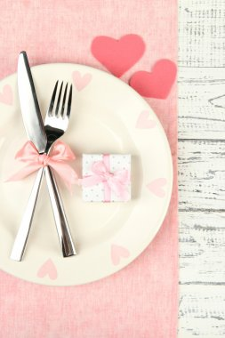 Romantic holiday table setting, on wooden background