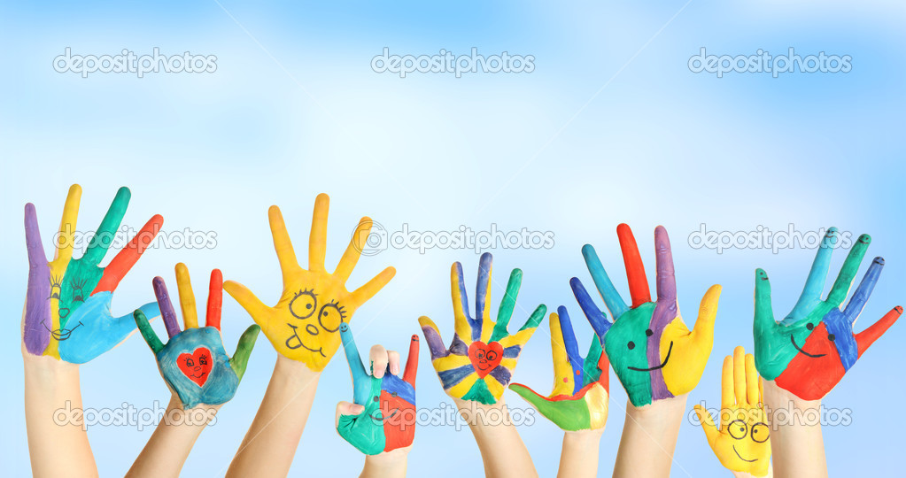 painted hands with smile on blue background stock photo