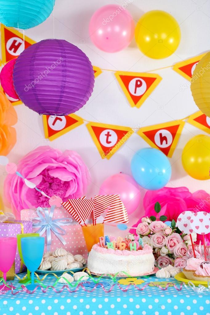 Festive table setting for birthday on celebratory decorations ...