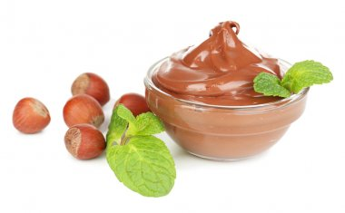 Sweet chocolate hazelnut spread with whole nuts and mint isolated on white