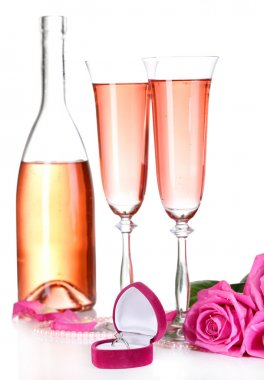 Composition with pink sparkle wine in glasses, bottle and pink roses isolated on white