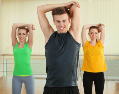 Young beautiful peoples engaged in gym
