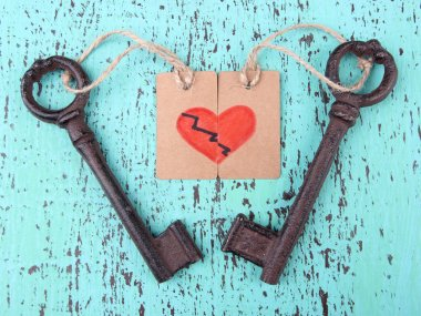 Keys to love, Conceptual photo. On color wooden background