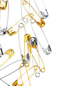 Safety pins isolated on white