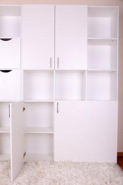 Empty white shelves close up