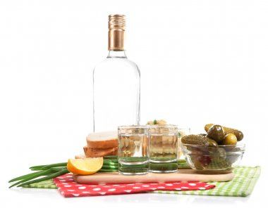 Composition with bottle of vodka and marinated mushrooms, cucumbers on wooden board isolated on white