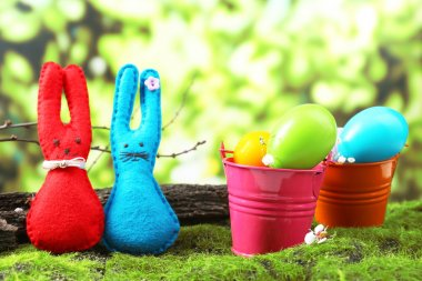 Funny handmade Easter rabbits on green grass