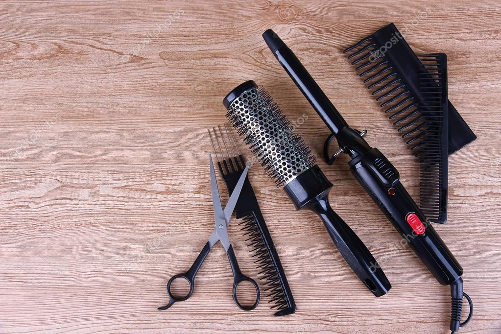 Professional hairdresser tools on wooden background