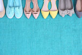 Photo Female fashion shoes on blue carpet