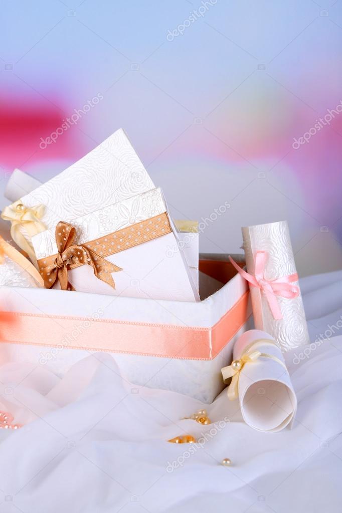 Beautiful handmade wedding cards in box on light background stock beautiful handmade wedding cards in box on light background photo by belchonock solutioingenieria Choice Image