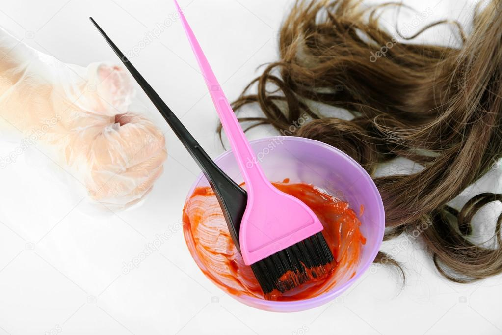 Female hand in gloves dips with brush for hair coloring, isolated ...