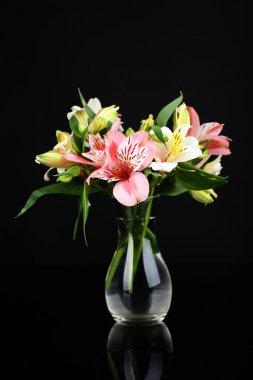 Alstroemeria flowers in vase on table on dark grey background