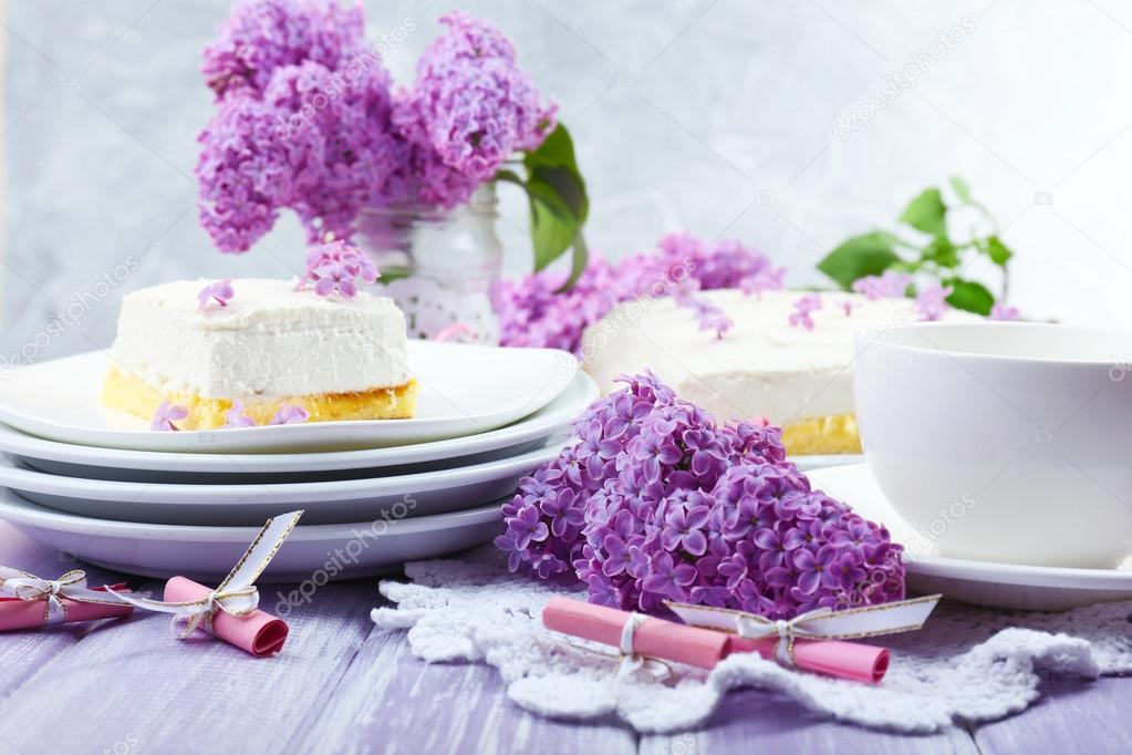 Delicious dessert with lilac flowers