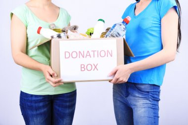 Volunteers with donation box with foodstuffs